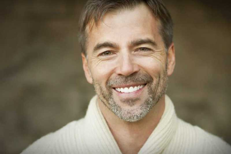 Close up image of a guy who smiles wide after the outcome of dental whitening in Salinas, CA