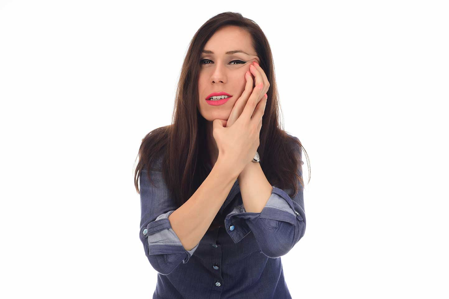 A young woman seeking TMJ treatment in Salinas, CA for a problematic tooth issue