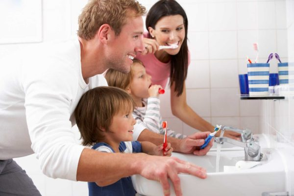 salinas family brushing teeth together